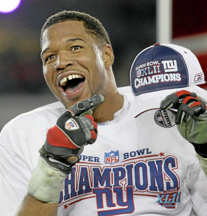 New York Giants defensive end Michael Strahan was a game-changer on the field, but he was also making his mark elsewhere with his gregarious personality, gap-toothed smile and willingness to step out of his comfort zone. Photo: David J. Phillip — The Associated Press File Photo  / AP