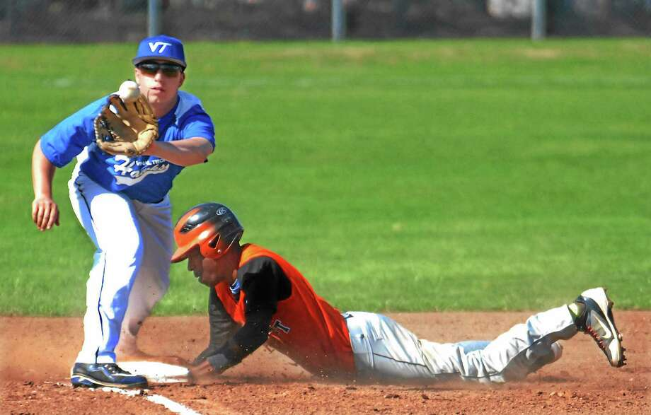 Bullard Haven Tech senior Kavon Ruffin steals third as Vinal Tech junior Mike Greco waits for the ball Monday afternoon in Middletown. Vinal lost 5-4. Photo: Jimmy Zanor — The Middletown Press