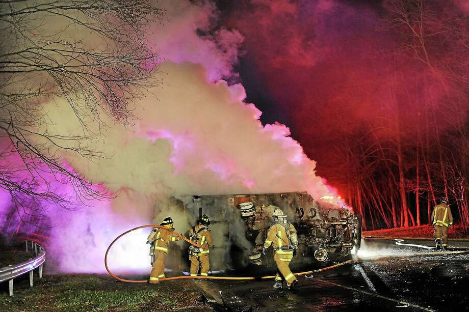 Olivia Drake photo Two men remain in the hospital following a fiery head-on collision early Monday morning on the Route 82 Connector at Route 9, Exit 7, in Haddam. Photo: Journal Register Co.