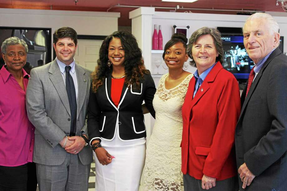 Jennifer De Kine of the Middlesex Chamber, Mayor Dan Drew, DíYaze Owner Doris Perry, Mariah Perry, Chamber Chairwoman Darlene Briggs, Chamber President Larry McHugh at the opening of the new hair salon in Middletown. Photo: Submitted Photo