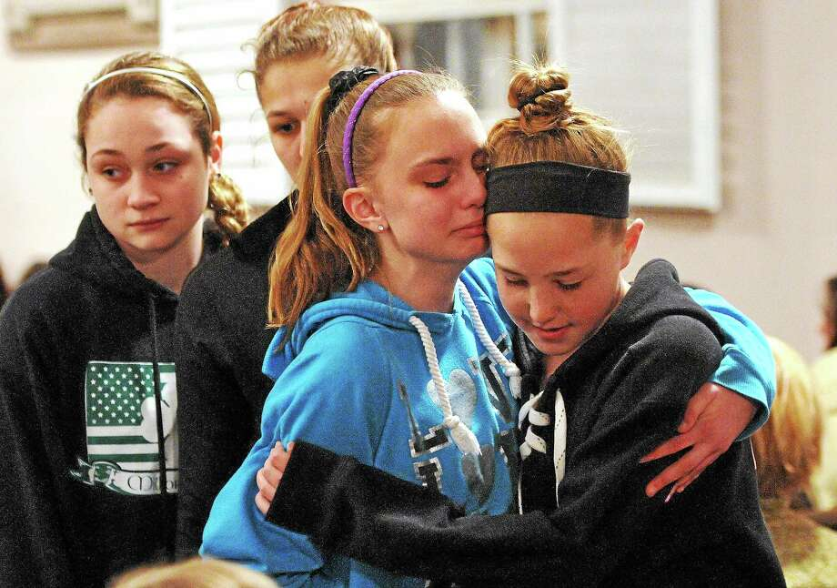 Friends and family, including many students from Jonathan Law High School, attend a memorial service Friday night at the First United Church of Christ for Maren Sanchez who was killed at the school Friday. Photo: Peter Casolino — New Haven Register