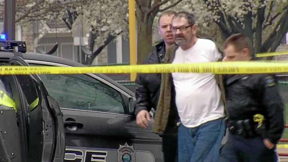 In this Sunday, April 13, 2014 image from video provided by KCTV-5, Frazier Glenn Cross, also known as Frazier Glenn Miller, is escorted by police in an elementary school parking lot in Overland Park, Kan. Cross, 73, accused of killing three people in attacks at a Jewish community center and Jewish retirement complex near Kansas City, is a known white supremacist and former Ku Klux Klan leader who was once the subject of a nationwide manhunt. (AP Photo/KCTV-5) MANDATORY CREDIT Photo: AP / KCTV-5