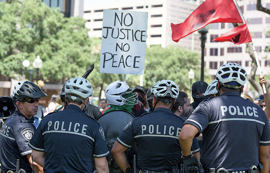 "A San Antonio police officer allegedly said ""F--- you, f----t"" to a man during a confrontation at the Travis Park Confederate statue removal in September. The officer was suspended without pay for three day.Click ahead to view photos of protesters squaring off in Travis Park over the controversial statue. Photo: B. Kay Richter, For MySA"