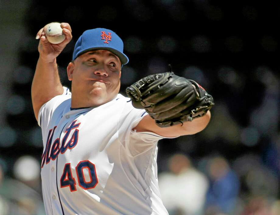 Mets starter Bartolo Colon delivers in the first inning against the St. Louis Cardinals on Thursday in New York. Photo: Kathy Willens — The Associated Press  / AP