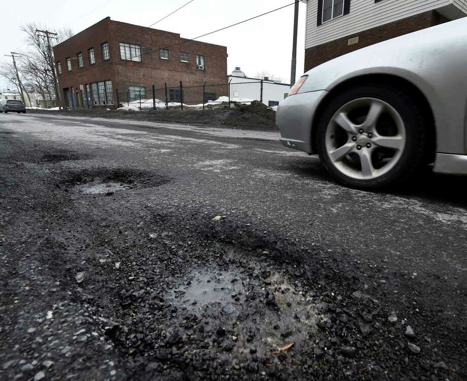 Erie Boulevard is heavily spotted with many potholes which were put on the list for repair by the Schenectady Public Works Department Thursday March 5, 2015 in Schenectady, N.Y.    (Skip Dickstein/Times Union) Photo: SKIP DICKSTEIN / 10030891A