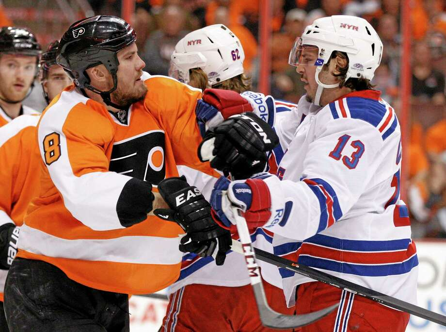 The Flyers' Nicklas Grossmann, left, gets into a pushing match with the New York Rangers' Daniel Carcillo during the first period of Game 3 of their first-round playoff series on Tuesday in Philadelphia. Photo: Chris Szagola — The Associated Press  / FR170982 AP