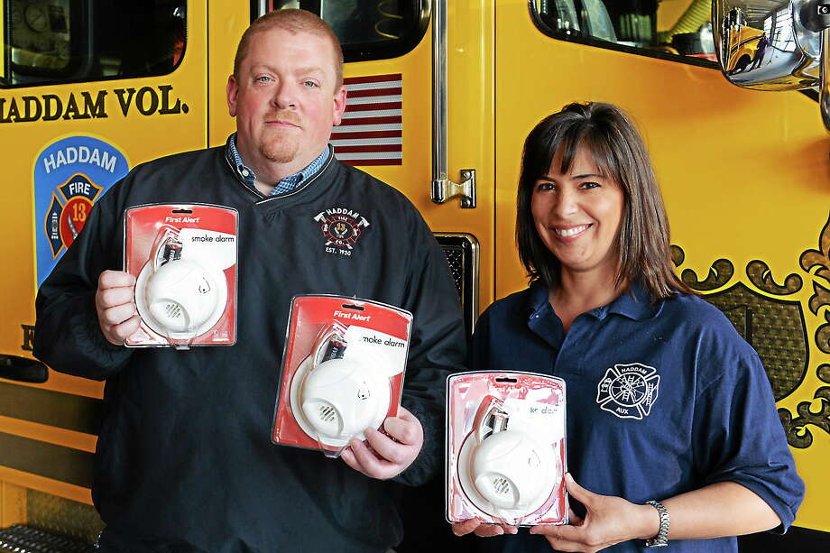 Photo by Olivia Drake Haddam Volunteer Fire Department President Scott Larson and HVFC Auxiliary President Candy Veazie encourage all Haddam area residents in need to request a smoke alarm. Photo: Journal Register Co.