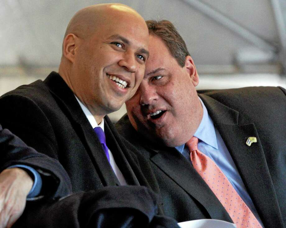 FILE - In this Feb. 9, 2012 file photo, New Jersey Gov. Chris Christie, right, talks with Newark Mayor Cory A. Booker during groundbreaking ceremonies for the Teachers Village development in downtown Newark, N.J. A New Jersey Democratic county chairman says Booker has told him heís considering running for governor against Chris Christie in 2013, according to The Associated Press, Friday, Aug. 24, 2012. (AP Photo/Mel Evans, File) Photo: AP / AP
