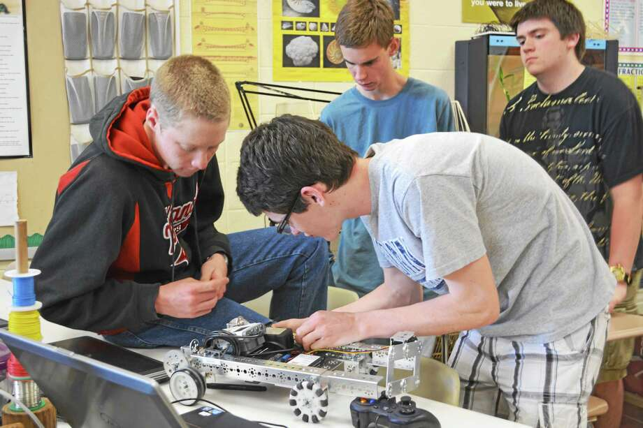 Portland High School team members built and rebuilt their robot numerous times, working on building and programming, throughout the school year. Photo: Kaitlyn Schroyer — The Middletown Press