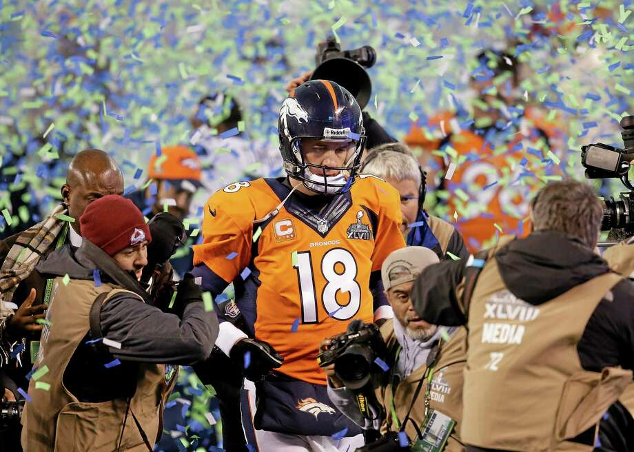 In this Feb. 2 file photo, Denver quarterback Peyton Manning walks off the field after the Broncos lost to the Seattle Seahawks in Super Bowl XLVIII in East Rutherford, N.J. Photo: Chris O'Meara — The Associated Press File Photo  / AP