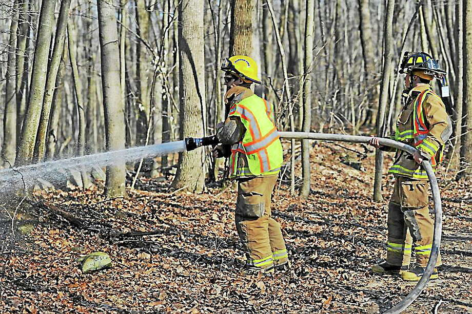 Courtesy Haddam Volunteer Fire Co. Haddam Volunteer Fire Co. battles a brush fire in town over the weekend. Photo: Journal Register Co.