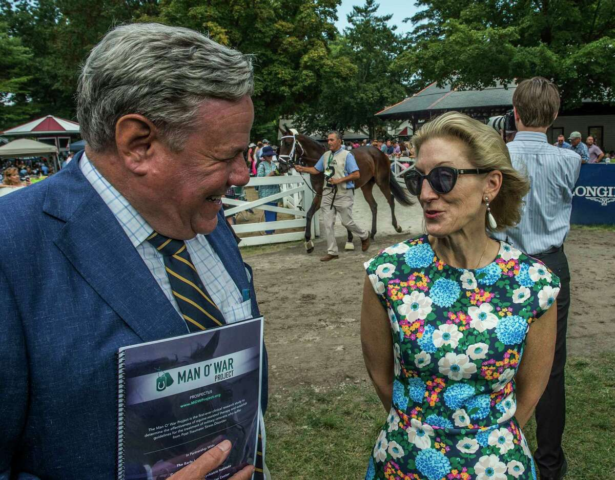 Jamie McGuire, left and Anne Poulson discuss the Man O' War program as they stand in the paddock at the Saratoga Race Course Aug. 12, 2017 in Saratoga Springs, N.Y. (Skip Dickstein/Times Union)