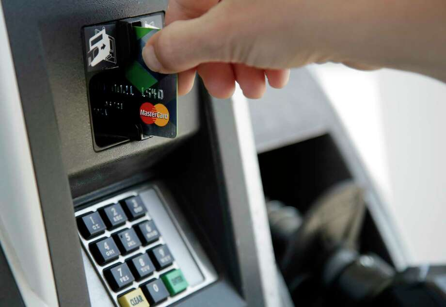 In this June 15, 2017, photo, a customer inserts a credit card to buy gas in Haverhill, Mass. The more you know about credit cards, how they work and how they fit into your financial life, the more likely you are to use them wisely. (AP Photo/Elise Amendola) ORG XMIT: MAEA505 Photo: Elise Amendola / Copyright 2017 The Associated Press. All rights reserved.