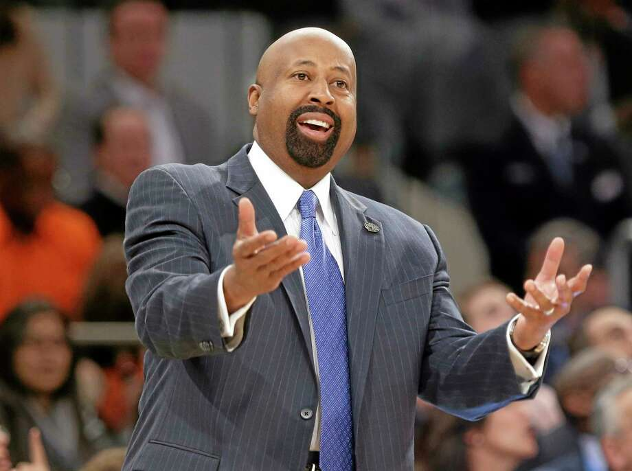 "FILE - In this April 4, 2014 file photo, New York Knicks head coach Mike Woodson reacts to a call during the first half of an NBA basketball game against the Washington Wizards, in New York. The Knicks have fired Woodson after falling from division champions to out of the playoffs in one season. New team president Phil Jackson made the decision Monday, April 21, 2014, saying in a statement ""the time has come for change throughout the franchise."" (AP Photo/Frank Franklin II, File) Photo: AP / AP"