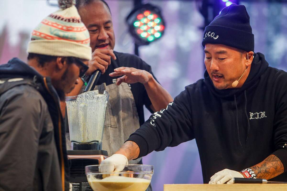 Del the Funky Homosapien, left, producer Dan the Automator, middle, Chef Roy Choi, right, demo a marinated rib recipe on the GastroMagic Stage during the 10th annual Outside Lands Festival in Golden Gate Park in San Francisco on Saturday, August 12, 2017.