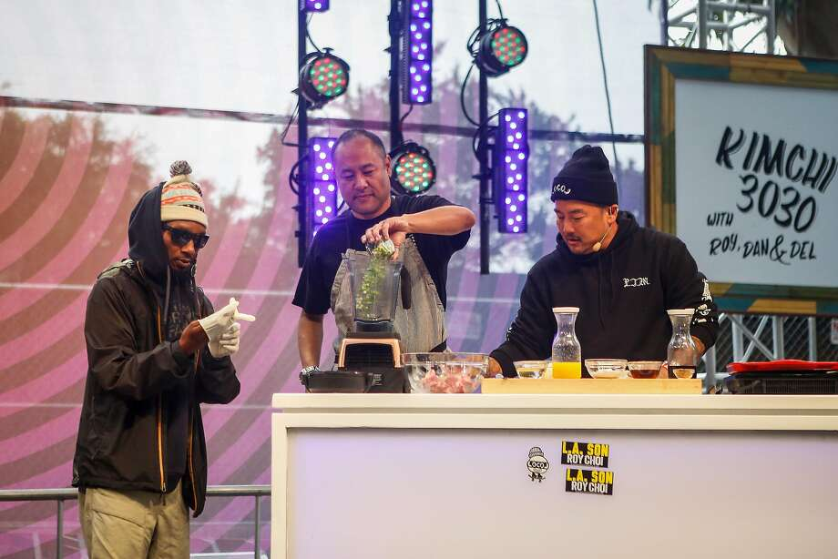 Del the Funky Homosapien, left, producer Dan the Automator, middle, Chef Roy Choi, right, demo a marinated rib recipe on the GastroMagic Stage during the 10th annual Outside Lands Festival in Golden Gate Park in San Francisco on Saturday, August 12, 2017. Photo: Nicole Boliaux, The Chronicle