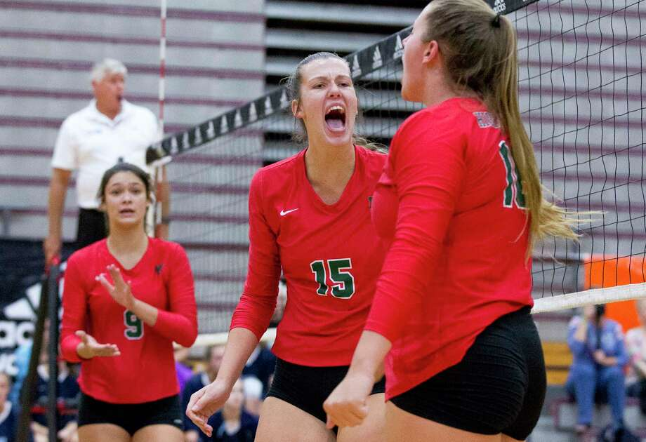 The Woodlands right side hitter Alex Tyler (15) celebrates after a kill shot by middle blocker AJ Koele (16) in the first set of a match during the Adidas John Turner Classic at Pearland High School, Saturday, Aug. 12, 2017, in Pearland. The Woodlands defeated Prosper 2-1. Photo: Jason Fochtman, Staff Photographer / © 2017 Houston Chronicle