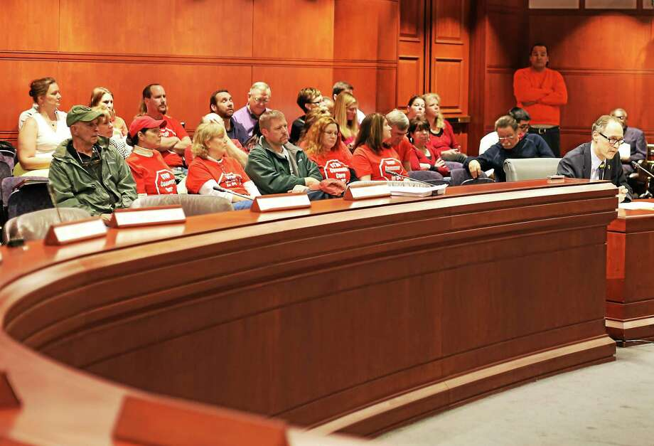 Christine Stuart - CTNewsJunkie.com ¬ Parents wear ëStop the Common Core in CTí t-shirts during a public hearing on Common Core state standards Wednesday. Photo: Journal Register Co.