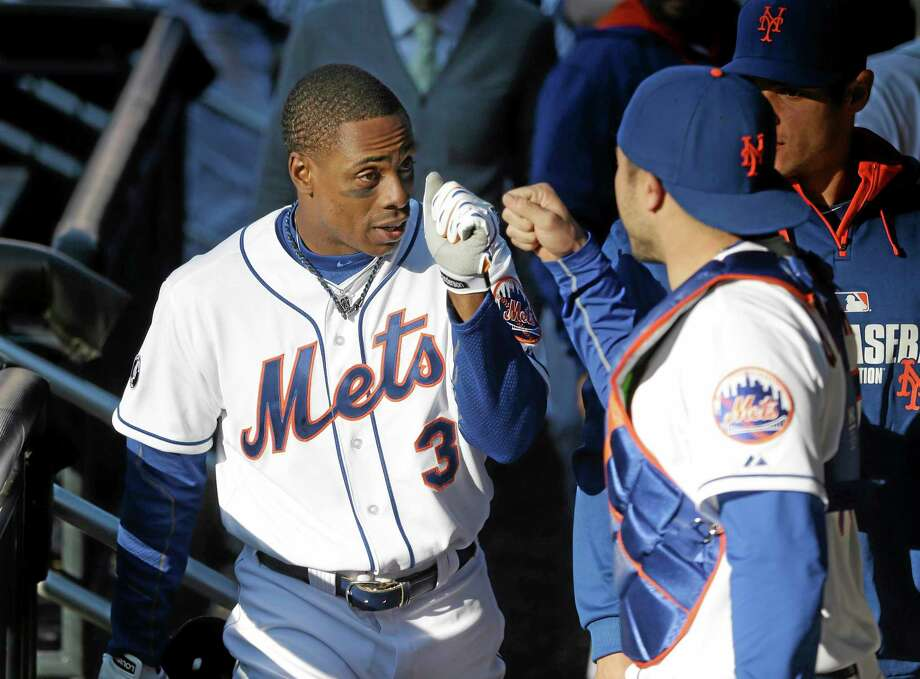 New York Mets' Curtis Granderson celebrates with teammates in the dugout after hitting a walk-off sacrifice fly during the fourteenth inning of the baseball game against the Atlanta Braves at Citi Field, Sunday, April 20, 2014 in New York. The Mets defeated the Braves in extra innings 4-3. (AP Photo/Seth Wenig) Photo: AP / AP