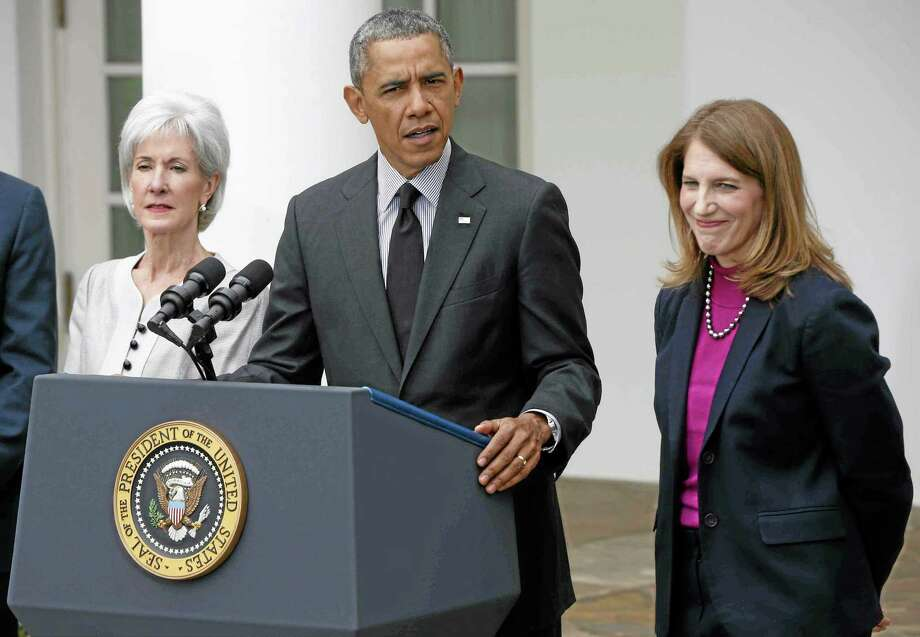 President Barack Obama, flanked by outgoing Health and Human Services Secretary Kathleen Sebelius, left, and his nominee to be her replacement, Budget Director Sylvia Mathews Burwell, speaks in the Rose Garden of the White House in Washington, Friday, April 11, 2014. The moves come just over a week after sign-ups closed for the first year of insurance coverage under the so-called Obamacare law. (AP Photo/Charles Dharapak) Photo: AP / AP
