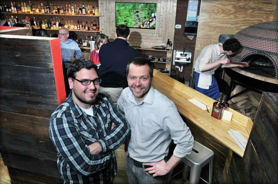 Kevin Wirtes and Rich Garcia own Krust artisan pizza and bourbon bar in Middletown's North End in this 2013 file photo. Photo: Catherine Avalone — The Middletown Press  / TheMiddletownPress