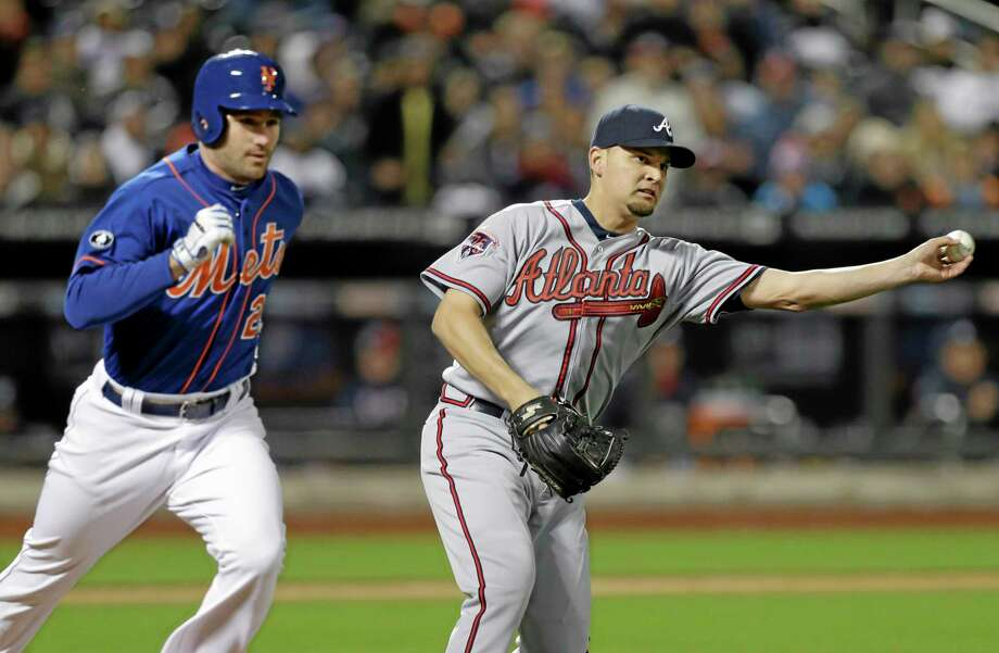 Atlanta Braves pitcher Luis Avilan relieved Aaron Harang after seven no-hit innings and gave up a single to the Mets' David Wright in the eighth on Friday night in New York. Photo: Frank Franklin II — The Associated Press  / AP