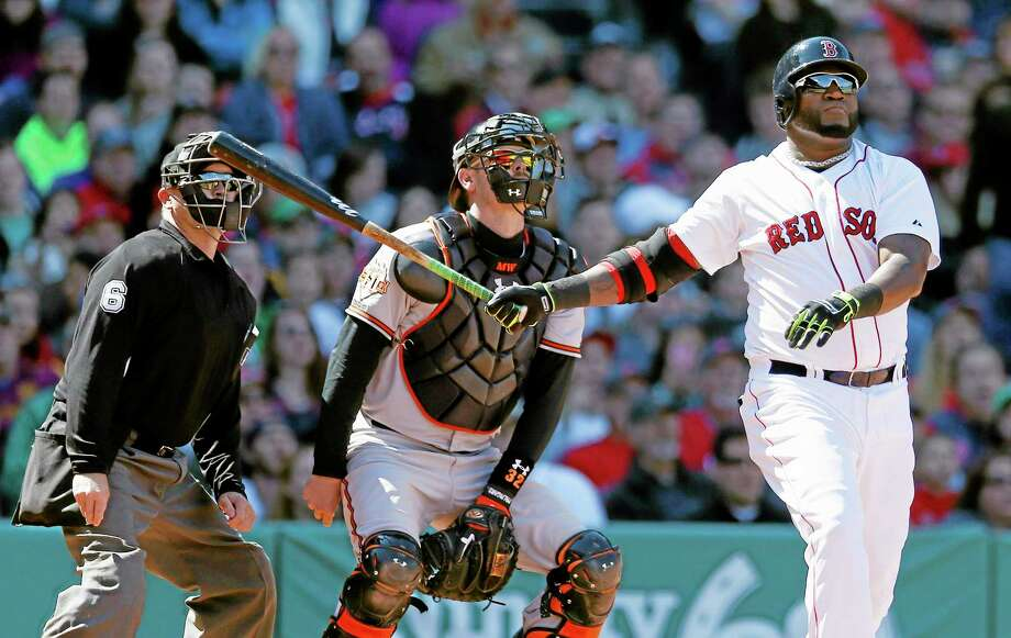Red Sox designated hitter David Ortiz watches his home run in front of Baltimore Orioles catcher Matt Wieters in the fourth inning of Saturday's game in Boston. Photo: Michael Dwyer — The Associated Press  / AP