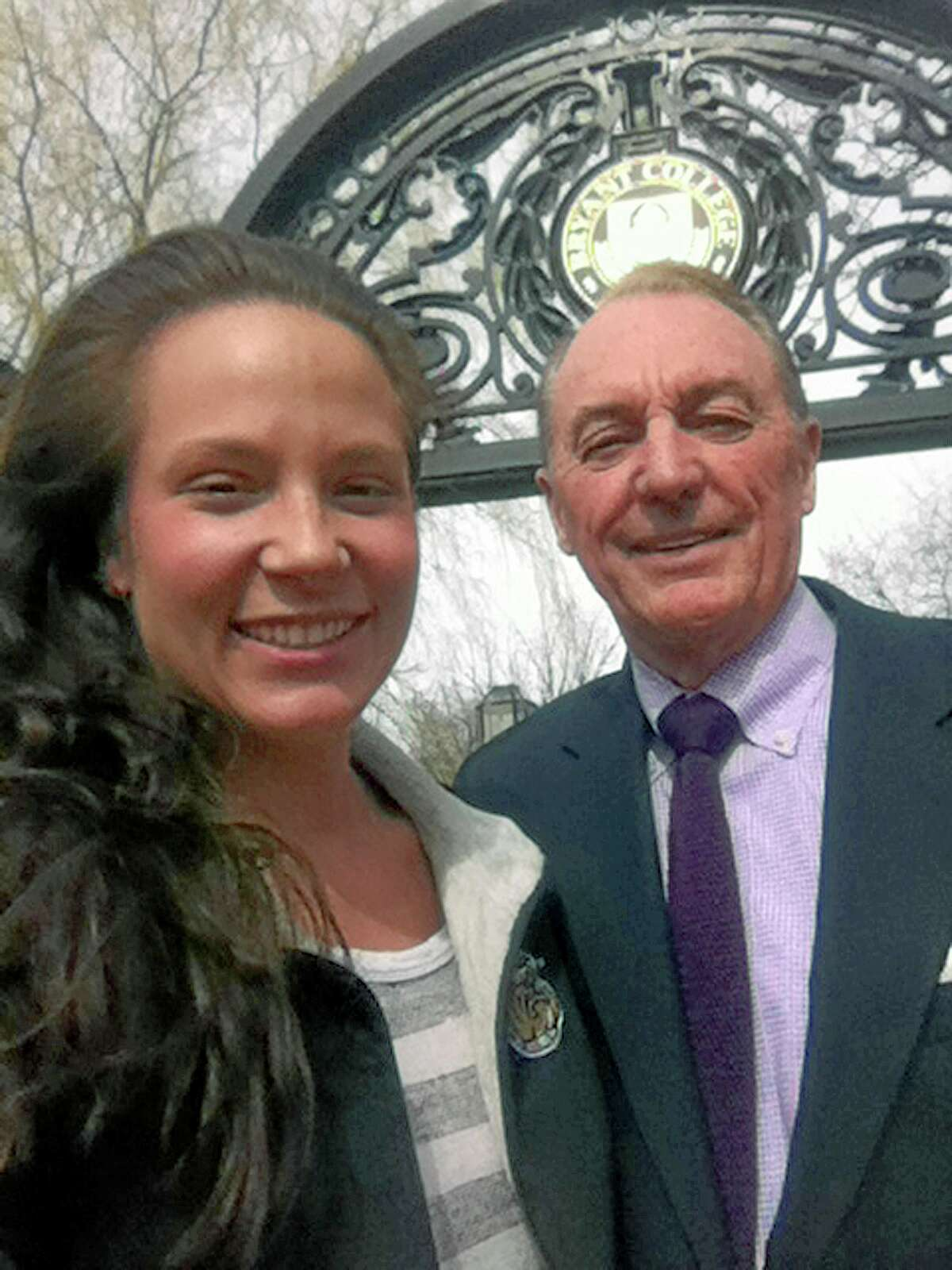 This photo taken Friday and provided by Ali Luthman, left, of Worcester, Mass., shows her with Bryant University President Ronald Machtley on the school's campus in Smithfield, R.I.. Although Machtley, who is active on social media, loves posing for pictures with the students, the university has asked graduates to resist the urge to take a selfie with him when receiving their diploma this year, saying it will greatly prolong the graduation ceremony. Machtley says he is happy to take some after the service though.