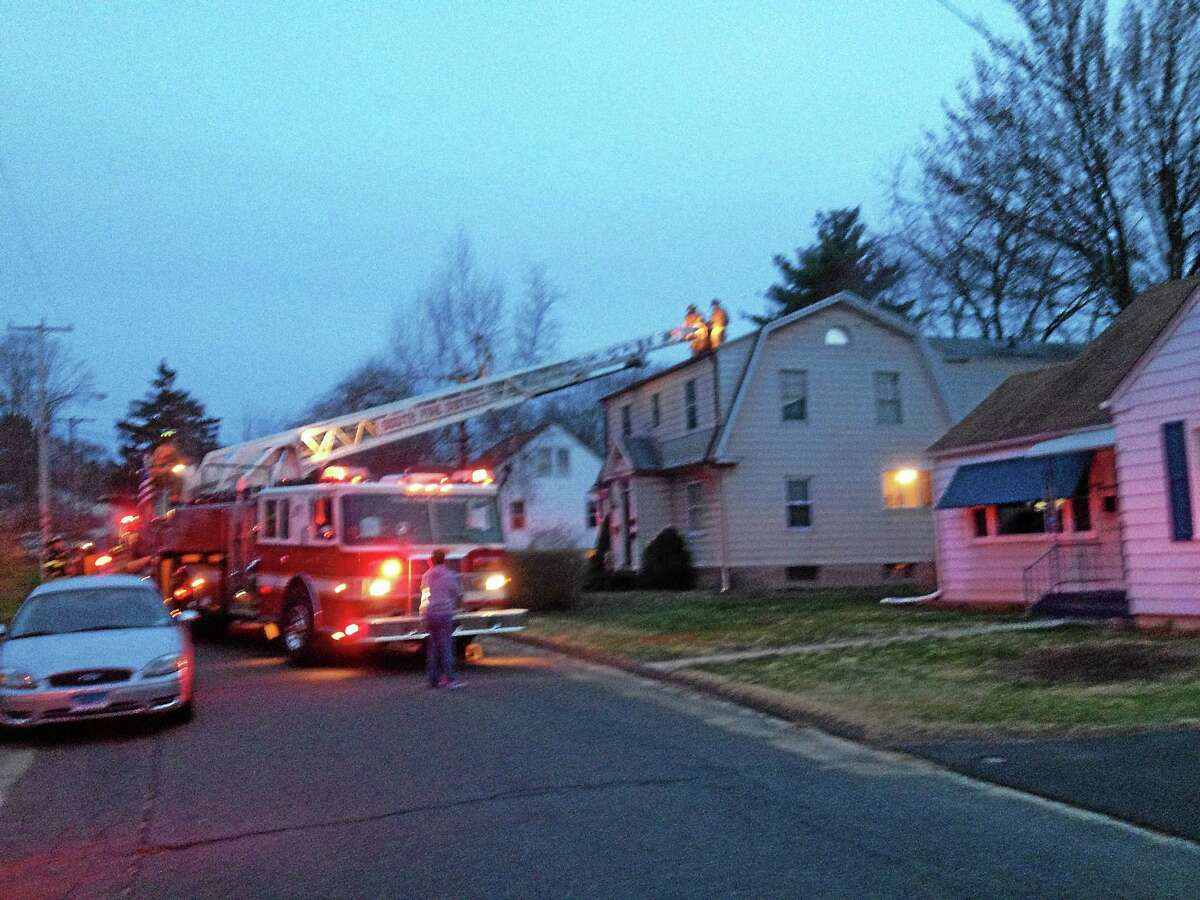 Jeff Mill - The Middletown Press South Fire District Firefighter to a fire at a Frissell Street home Friday evening.