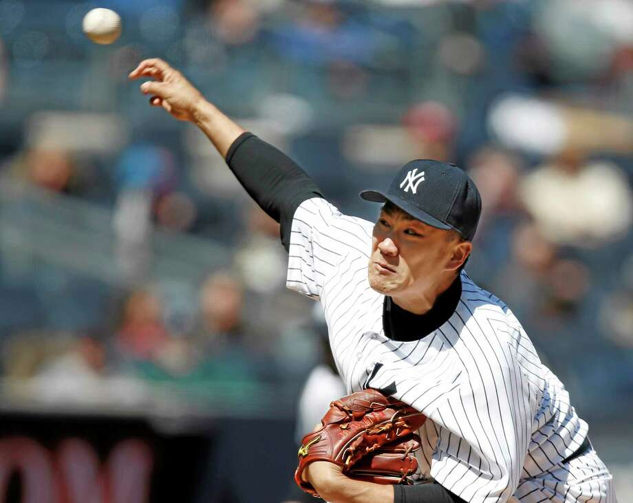 Yankees starter Masahiro Tanaka allowed just two bunt hits over eight innings in New York's 3-0 win over the Chicago Cubs on Wednesday at Yankee Stadium in the Bronx. Photo: Kathy Willens — The Associated Press  / AP