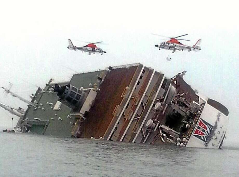Rescue helicopters fly over a sinking South Korean passenger ferry that was carrying more than 450 passengers, mostly high school students, Wednesday, April 16, 2014, off South Korea's southern coast. Hundreds of people are missing despite a frantic, hours-long rescue by dozens of ships and helicopters. At least four people were confirmed dead and 55 injured. (AP Photo/Yonhap) KOREA OUT Photo: AP / Yonhap