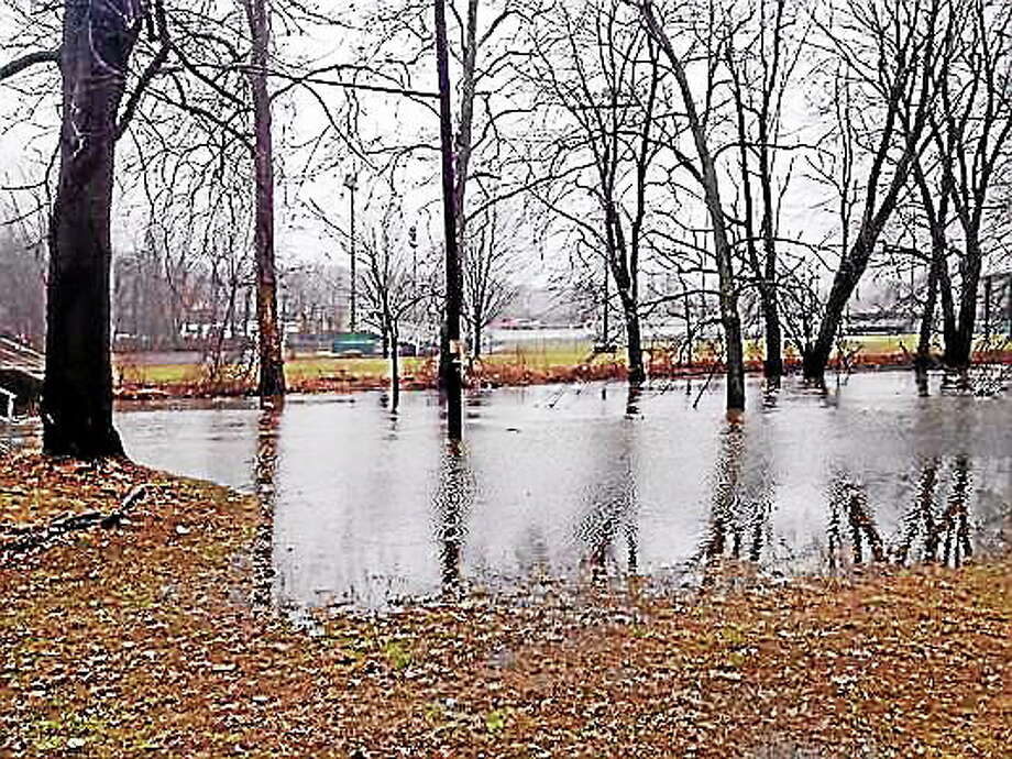 Cassandra Day - The Middletown Press The Coginchaug River at Middletown's Veteran's Park overflows its banks. Photo: Journal Register Co.