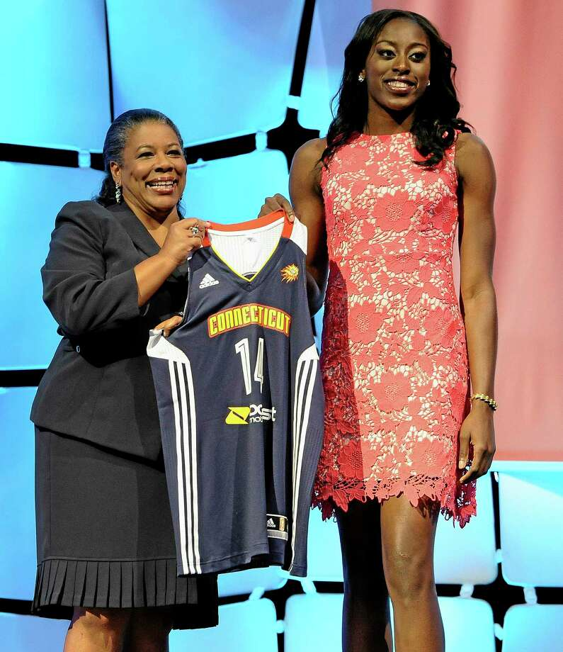Stanford's Chiney Ogwumike holds up Connecticut Sun jersey with WNBA president Laurel J. Richie after the Sun selected Ogwumike with the No. 1 pick in the WNBA Draft Monday in Uncasville. Photo: Jessica Hill — The Associated Press  / FR125654 AP