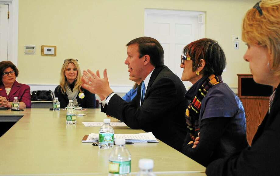 Viktoria Sundqvist - The Middletown Press ¬ U.S. Sen. Chris Murphy and U.S. Rep. Rosa DeLauro talk to a group of women leaders in Middletown about minimum wage on Wednesday. Photo: Journal Register Co.