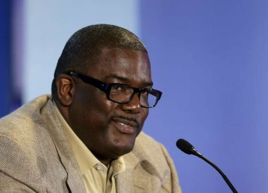 The Detroit Pistons President of Basketball Operations Joe Dumars is seen during a news conference at the Palace of Auburn Hills, Mich., where guard Brandon Jennings was introduced to the media, Tuesday, Aug. 6, 2013. Jennings comes from the Milwaukee Bucks, who acquired Brandon Knight, Slava Kravtsov and Khris Middleton in a sign-and-trade deal last week. Jennings signed a 3-year, $24-million deal as part of the deal. (AP Photo/Carlos Osorio) Photo: AP / AP2013