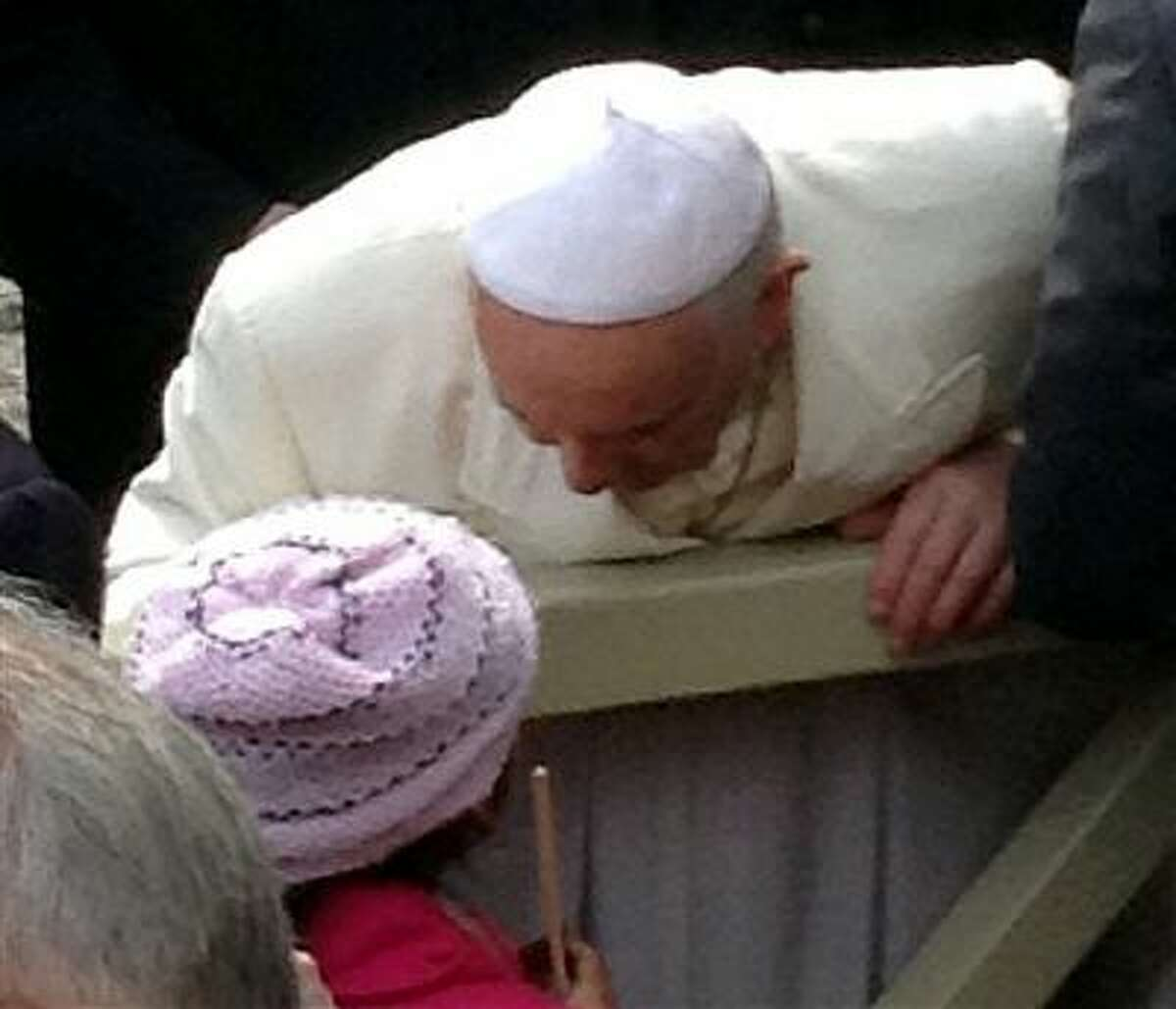 In this March 26, 2014, photo provided by Catholic Coalition of Immigrant Rights, Pope Francis leans down to talk to 10-year-old Jersey Vargas, who traveled to the Vatican from Los Angeles to plead with him to help spare her father from deportation, during a public audience at St. Peter's Square in Vatican City. Her father, Mario Vargas, in the United States illegally, had been in federal custody and faced possible deportation. After speaking with Francis, Mario Vargas was released on bond from immigration detention, Immigration and Customs Enforcement said Friday, March 28, 2014. Jersey Vargas was part of a California delegation that sought to encourage the Vatican to prod President Obama on immigration reform. (AP Photo/Catholic Coalition of Immigrant Rights)