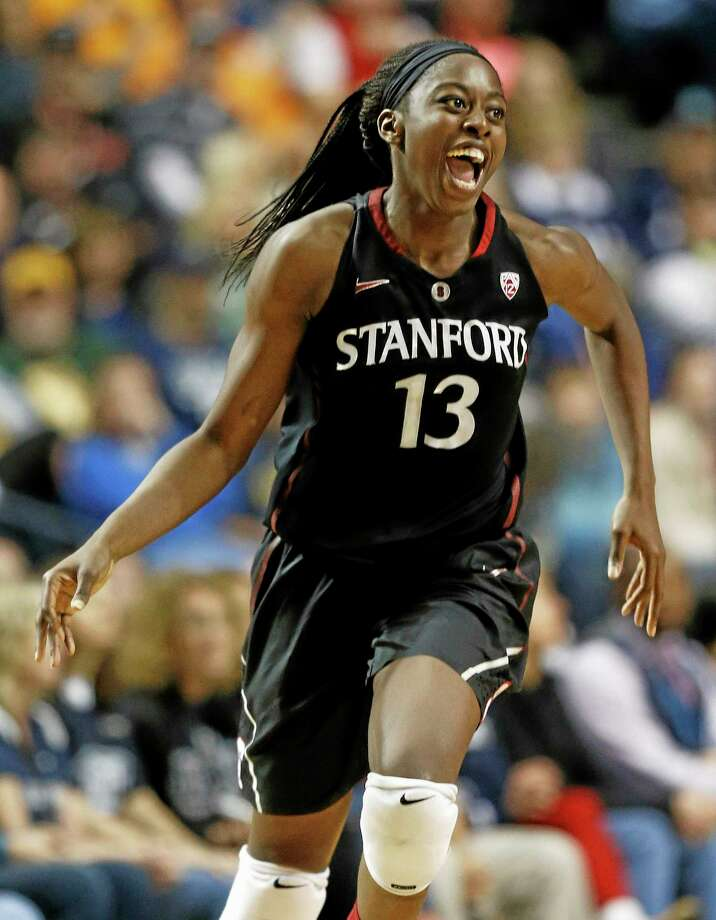 Stanford forward Chiney Ogwumike (13) celebrates a basket against Connecticut during the second half of the semifinal game in the Final Four of the NCAA women's college basketball tournament, Sunday, April 6, 2014, in Nashville, Tenn. (AP Photo/John Bazemore) Photo: AP / AP