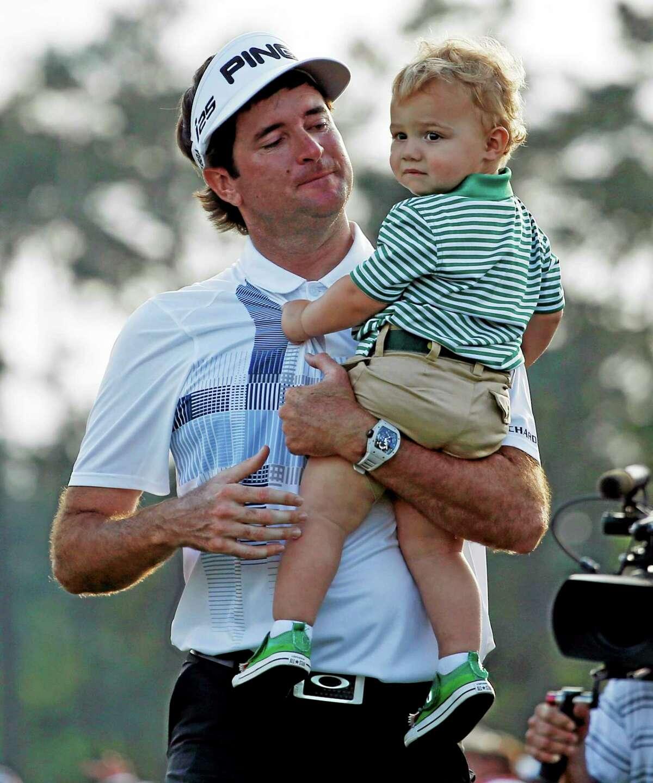 Bubba Watson carries his son Caleb after winning the Masters Sunday in Augusta, Ga. (AP Photo/Matt Slocum)