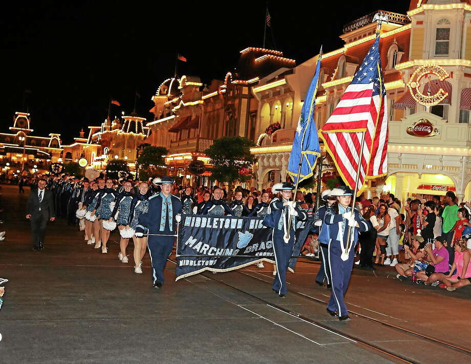 Middletown High School Marching Band marches in Magic Kingdom's Main Street Electrical Parade on April 12. Photo: Sandy Aldieri — Special To The Press
