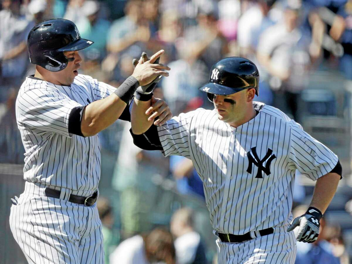 Carlos Beltran, left, and Brian McCann combined for three home runs during the Yankees' 7-4 win over the Boston Red Sox on Saturday afternoon at Yankee Stadium in the Bronx.