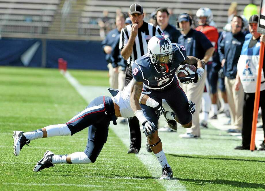 Connecticut blue team's Kamal Abrams is pushed out of bounds by the white team's Javon Hadley during the first half of UConn's Blue-White spring game at Rentschler Field on Saturday. Photo: Jessica Hill — The Associated Press  / FR125654 AP