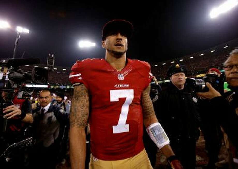 San Francisco 49ers' starting quarterback Colin Kaepernick (7) looks to shakes hands with other players following their 34-24 win against the Atlanta Falcons at Candlestick Park in San Francisco, Calif. on Monday, Dec. 23, 2013.  (Nhat V. Meyer/Bay Area News Group) Photo: San Jose Mercury News / San Jose Mercury News