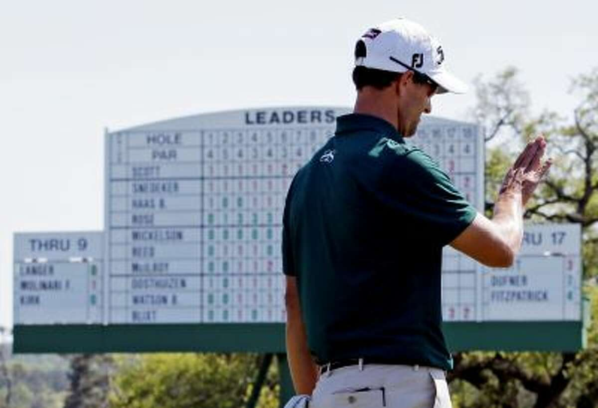 Adam Scott, of Australia, lines up his putt on the 18th green during the first round of the Masters golf tournament Thursday, April 10, 2014, in Augusta, Ga. (AP Photo/David J. Phillip)