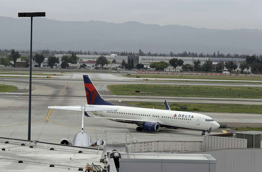 """A plane taxis after landing at Mineta San Jose International Airport, Monday, April 21, 2014, in San Jose, Calif. An unspecified """"security incident"""" at Terminal A on Saturday afternoon was causing flight delays. Photo: Eric Risberg, Associated Press"""