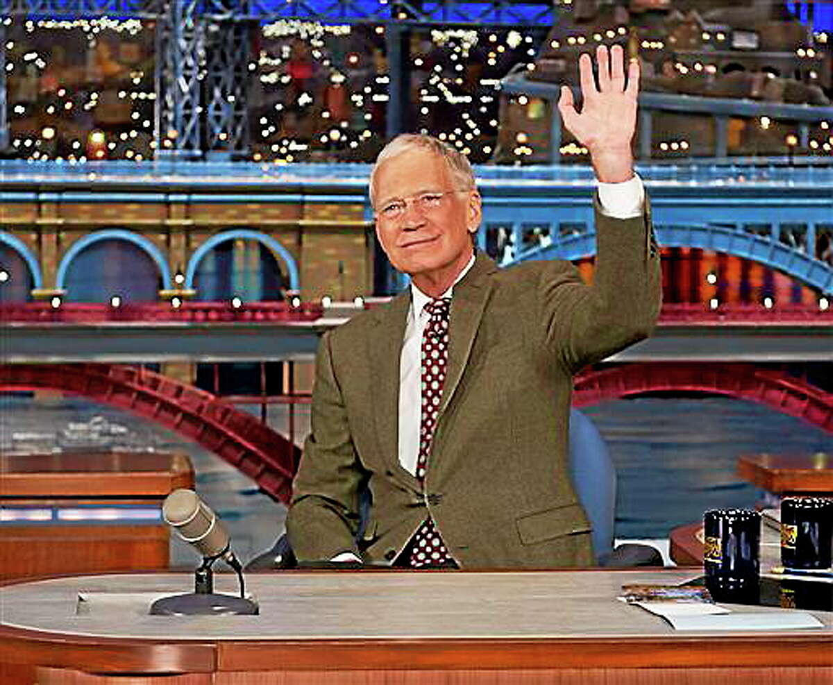 "In this photo provided by CBS, David Letterman, host of the Late Show with David Letterman, waves to the audience in New York on Thursday, April 3, 2014, after announcing that he will retire sometime in 2015. Letterman, who turns 67 next week, has the longest tenure of any late-night talk show host in U.S. television history, already marking 32 years since he created ""Late Night"" at NBC in 1982."