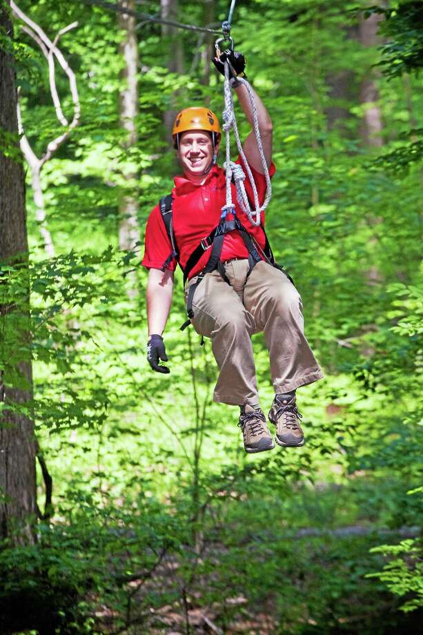 Submitted photo Empower of Middletown owner and former Army Captain Joe DeRing on zip lines. Photo: Journal Register Co. / Images Photography