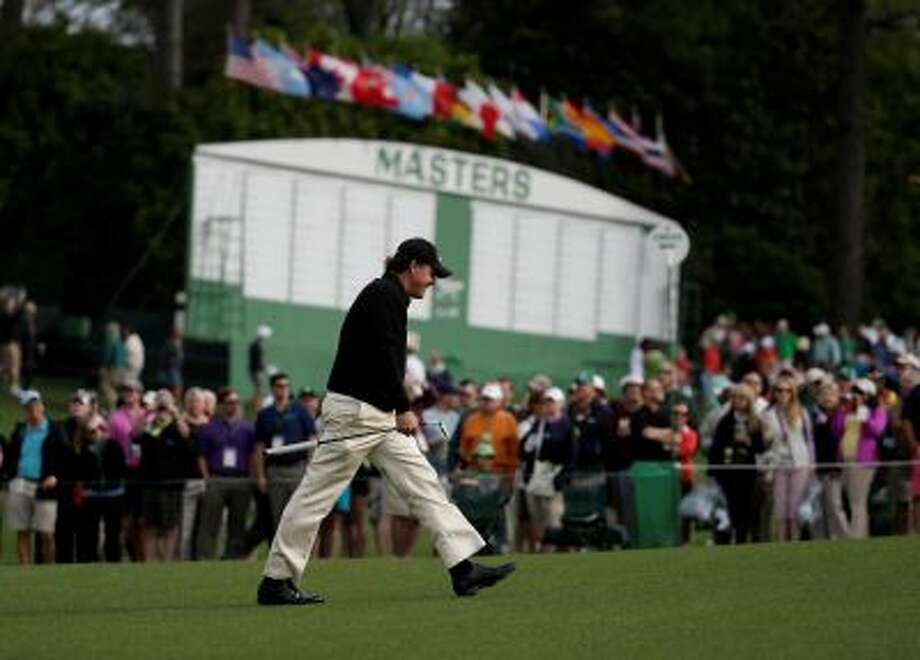 Phil Mickelson walks up the ninth fairway during a practice round for the Masters golf tournament Tuesday, April 8, 2014, in Augusta, Ga. (AP Photo/Darron Cummings) Photo: AP / AP2014