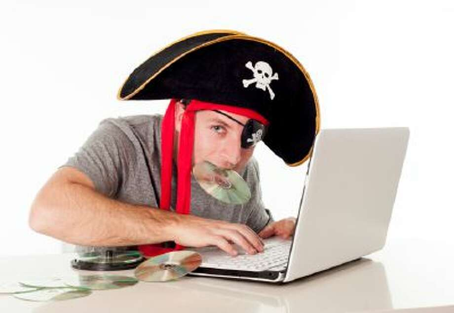 man in pirate hat downloading music on a laptop Photo: Getty Images/iStockphoto / iStockphoto