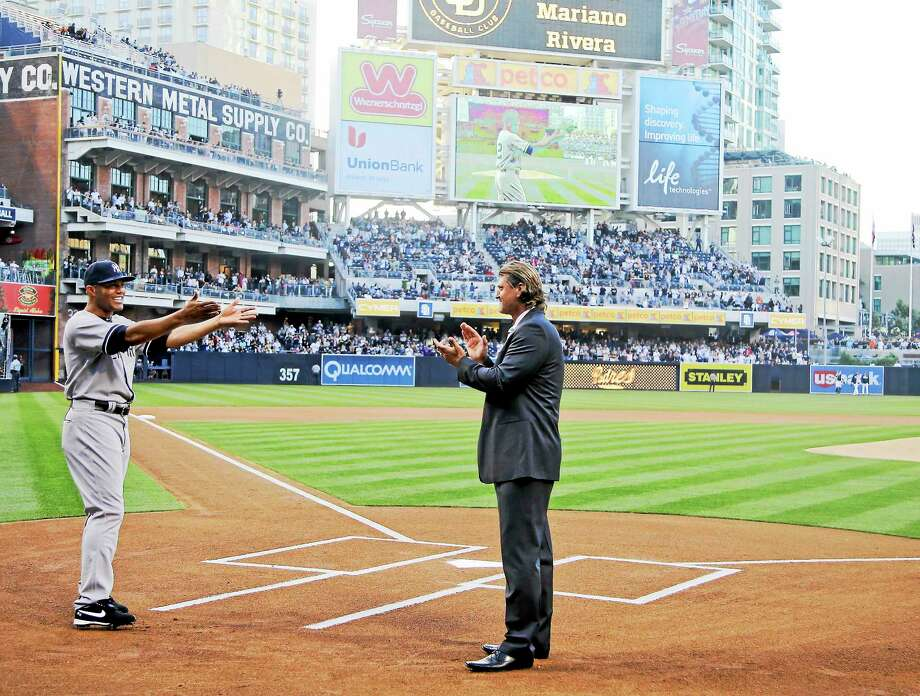 Major League Baseball announced Wednesday it will name the award for the top reliever in the American League after Mariano Rivera, left, and the top reliever in the National League after Trevor Hoffman, right. Photo: Lenny Ignelzi — The Associated Press File Photo  / AP2013