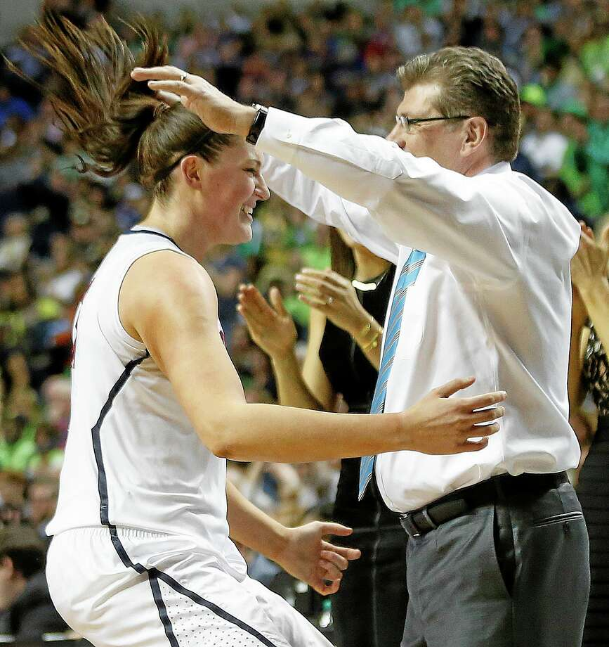 UConn senior center Stefanie Dolson embraces head coach Geno Auriemma in the closing moments of the Huskies' win over Notre Dame on Tuesday night in the national championship in Nashville, Tenn. Photo: John Bazemore — The Associated Press  / AP